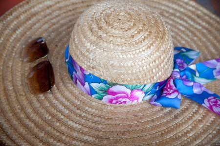 Summer straw hat and sunglasses photo