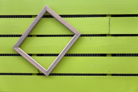 photo frame on color wood wall photo