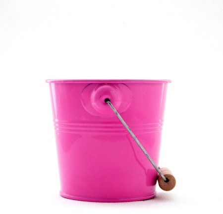 everyday jobs: Small iron milling red bucket on white Stock Photo