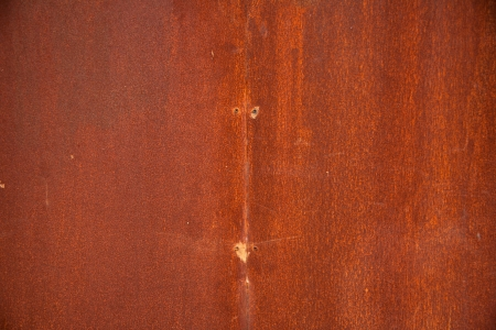 mottled: Rusty iron fence with mottled