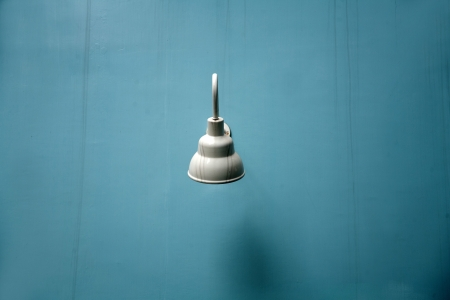 street light on blue wall photo