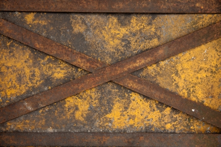 weathered cross steel on yellow iron door Stock Photo - 17342899