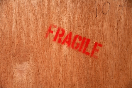 red fragile mark on wood Stock Photo - 17343404