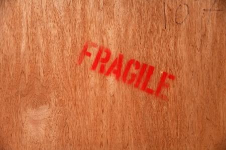 glued: red fragile mark on wood