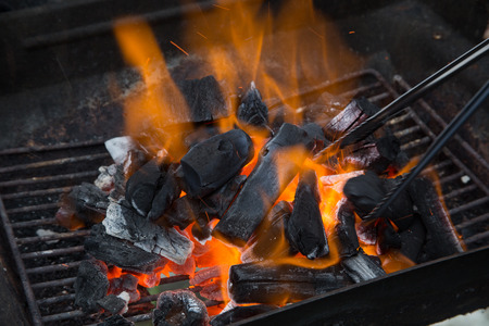 grill with flamesCharcoal fire photo