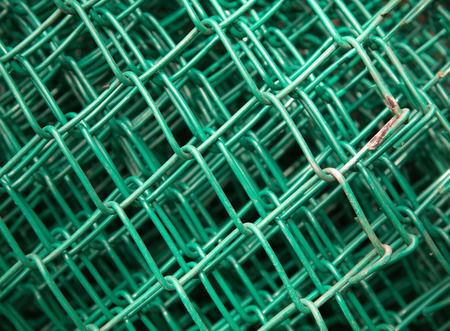 chainlink: green fence on ground