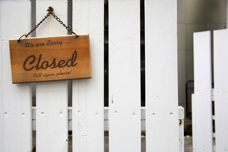 shopsign: shopsign on white fence closed