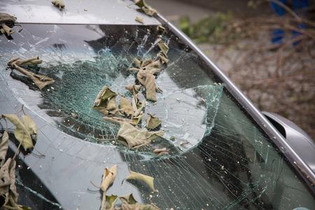 devastation: Typhoon damaged car windows Stock Photo