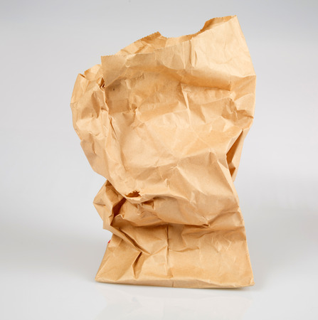 Paper bag with an empty cup photo