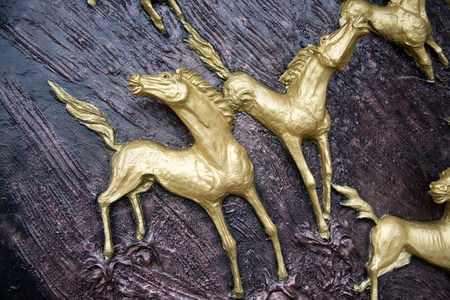 exquisite fairy: Golden Horses sculptures on the wall Stock Photo