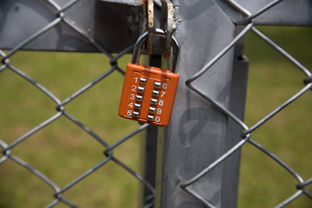ball chains: lock on fence Stock Photo