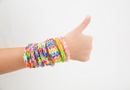 loom: Little girl wearing colorful loom band rubber bracelet