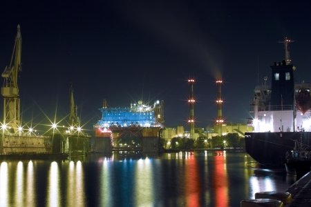 Night in shipyard, light, reflexes and colors. Stock Photo - 18779701