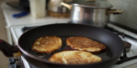 hashbrowns: Example of Polish cuisine, potato pancakes frying in a pan  Stock Photo