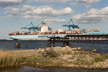 Gdansk, Poland - May, 17 2011: Bulk carrier Eleonora Maersk shipping line being loaded, unloaded in Gdansk, Poland. Many containers on deck. Editorial