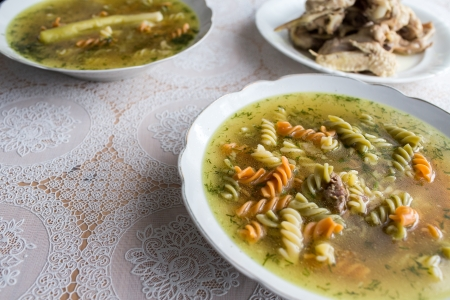 Broth with chicekn, turkey and beef, Polish cuisine. photo
