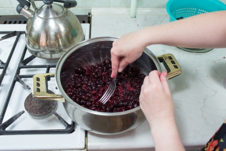 Preparation of cake with cherries and raspberries in Polish kitchen. photo