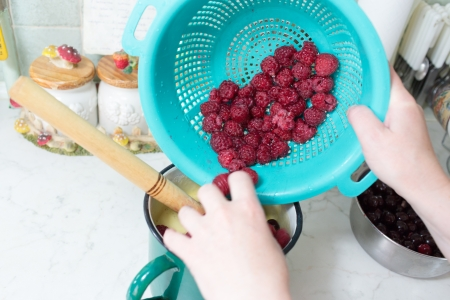 Preparation of cake with cherries and raspberries in Polish kitchen. Stock Photo - 21689796