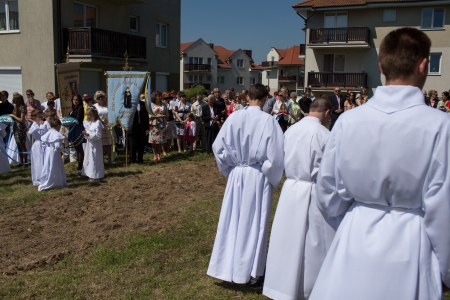 GDANSK KOWALE, POLAND - MAY 30 Religious procession at Corpus Christi Day in one of the suburban districts of Gdansk. May 30, 2013. Gdansk Kowale, Poland.