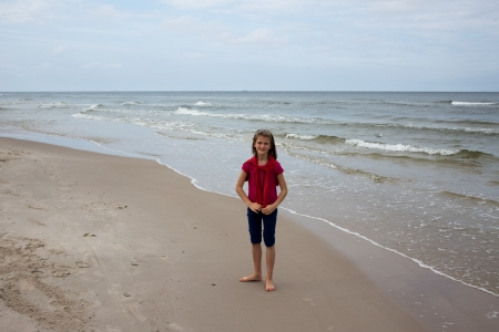 Young Girl Playing on the beach in Debki, Poland. photo