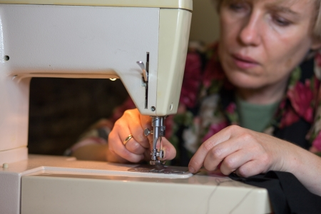 Working from home, a tailor at work. photo