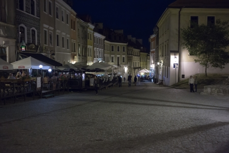 LUBLIN  POLAND - AUGUST 26 Tourists sightseeing Lublin old town at night  August 26, 2013  Lublin, Poland