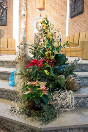 catechism: GDANSK PRZYMORZE, POLAND - JANUARY 26, 2014: The altar adorned with Christmas decorations. The interior of the church under the invocation. St. Brother Albert in Gdansk. Editorial