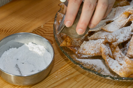 crunch: Preparing traditional Polish crunch cakes called Faworki or Chrust. Stock Photo