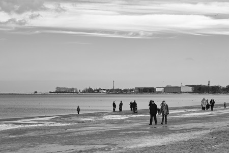 GDANSK BRZEZNO, POLAND - FEBRUARY 08, 2014: The people of Gdansk crowds visited the pier and the beach in Gdansk Brzezno during a sunny February day of winter.