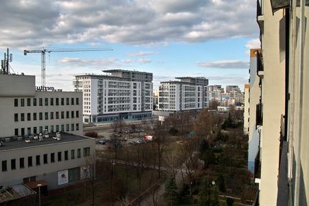 GDANSK ZASPA, POLAND - FEBRUARY, 23, 2014: Construction cranes in operation. View of the district of Gdansk-Zaspa.