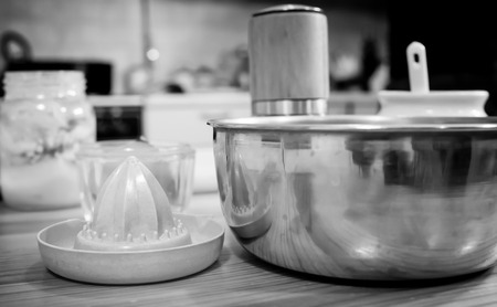 juice squeezer: Objects in the kitchen ready to use. In the photograph: salt, cup lemon juice squeezer pepper.