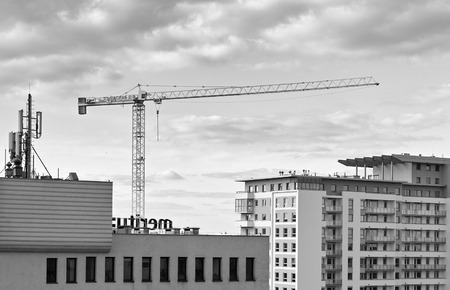 GDANSK, POLAND - FEBRUARY 23, 2014: Construction cranes in operation. View of the district of Gdansk-Zaspa.