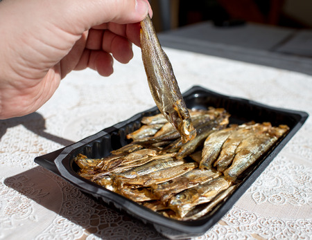 Before eating. Sprats on the Polish table in Polish kitchen. photo
