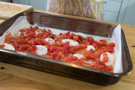 french pastry: In the Polish kitchen. On the polish table. Preparing a delicious casserole. Casserole Ingredients: french pastry, tomato, mozzarella, egg, pepper, salt, sour cream, salmon. Stock Photo