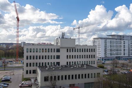 GDANSK ZASPA, POLAND - APRIL 13, 2014: Construction cranes in operation. View of the district of Gdansk-Zaspa.