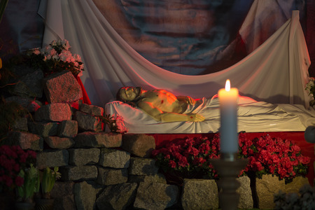 easter triduum: GDANSK PRZYMORZE, POLAND - APRIL 19, 2014  Sculpture of Jesus Christ is laid in the tomb  The staging of the tomb of the Lord during the Easter season  Catholic church under the invocation of St  brother Albert in Gdansk Przymorze