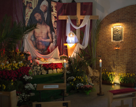GDANSK PRZYMORZE, POLAND - APRIL 19, 2014  Sculpture of Jesus Christ is laid in the tomb  The staging of the tomb of the Lord during the Easter season  Catholic church under the invocation of St  brother Albert in Gdansk Przymorze