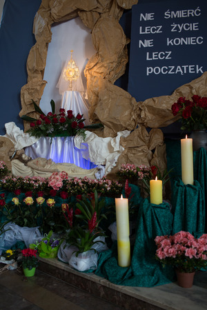 easter triduum: GDANSK BRZEZNO, POLAND - APRIL 19, 2014  Sculpture of Jesus Christ is laid in the tomb  The staging of the tomb of the Lord during the Easter season  Catholic church under the invocation of Saint Anthony in Gdansk Brzezno