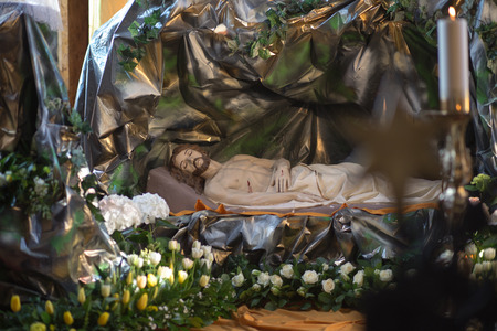 GDANSK OLIVA, POLAND - APRIL 19, 2014  Sculpture of Jesus Christ is laid in the tomb  The staging of the tomb of the Lord during the Easter season  Catholic Cathedral under the invocation of The Holy Trinity, Blessed Virgin Mary and St Bernard in Gdansk O