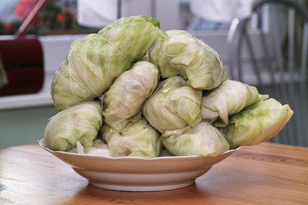 Cabbage rolls. In the Polish kitchen, on the Polish table. Preparing stuffed cabbage, Polish cuisine specialty. photo