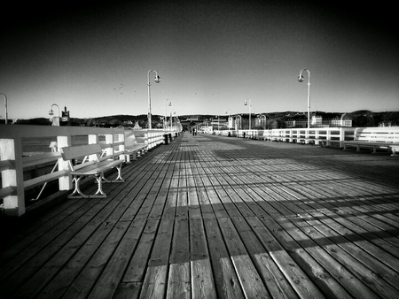 black: Morning winter on the pier in Sopot, Poland.