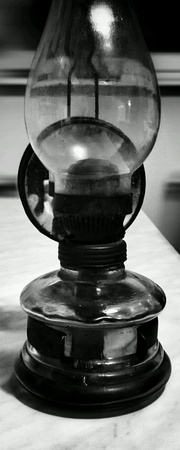 old items: The old oil lamp, household items as a still life. Stock Photo