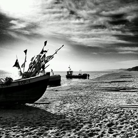 fishingboat: Boats on the beach. Sopot, Poland. Stock Photo