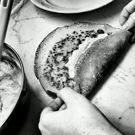 artistic: Prepare pancakes with cheese. Tasty meal in Polish cuisine.