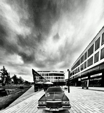 modern: American car and modern building in Gdynia Orlowo, Poland. Stock Photo