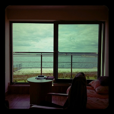 lomography: View from the window. Seascape on aesthetic Holga lomography. Stock Photo
