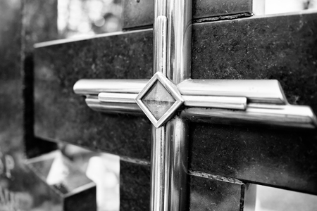 catholic cross: Catholic religious symbols on the Catholic cemeteries in Poland. Artistic look in black and white.