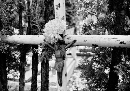 cemeteries: Catholic religious symbols on the Catholic cemeteries in Poland. Artistic look in black and white.