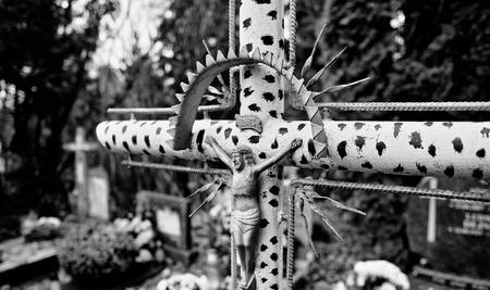 catholic: Catholic religious symbols on the Catholic cemeteries in Poland. Artistic look in black and white.