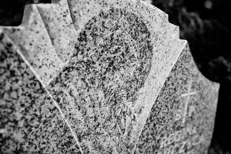 catholic symbol: Catholic religious symbols on the Catholic cemeteries in Poland. Artistic look in black and white.